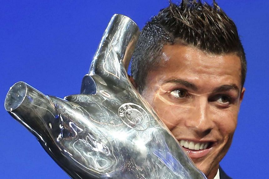 Real Madrid's Cristiano Ronaldo reacts as he receives the Best Player Uefa 2015/16 Award in Monaco.