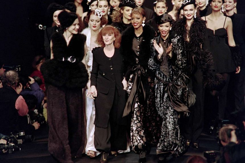 Sonia Rykiel (centre) surrounded by her models on the catwalk in Paris in 1994.