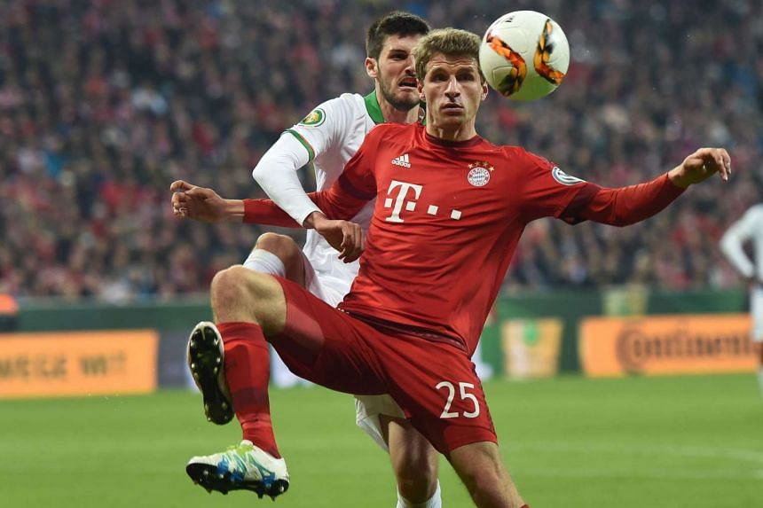 Bayern Munich's Thomas Mueller (right) and Bremen's Florian Grillitsch during the German Cup semi-final football match in Munich on April 19.