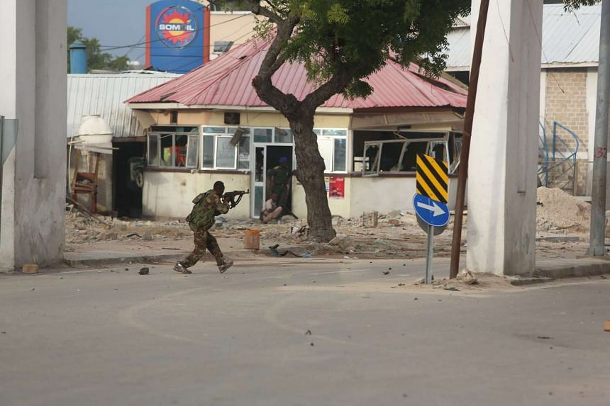 A Somali government soldier runs to take position during an attack in Somalia's capital Mogadishu on June 25, 2016.