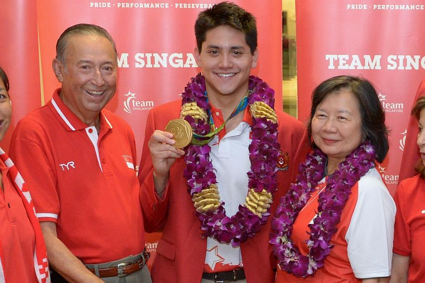 National swimmer Joseph Schooling, Singapore's Olympic gold medallist, with his parents Colin and May at Changi Airport Terminal 3 on 15 August 2016.