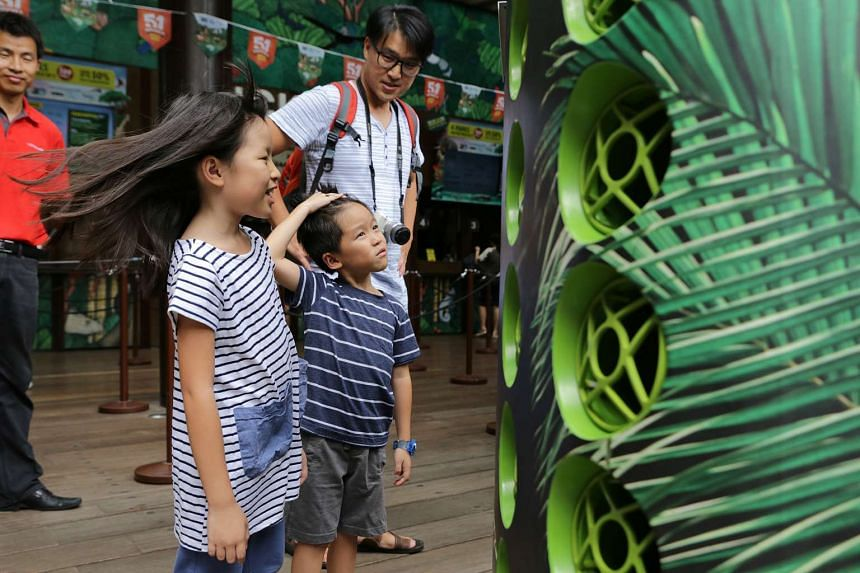 Steffi Teo, 8, and her brother Leroy, 6, enjoying the cool air from the Airbitat Smart Cooler.