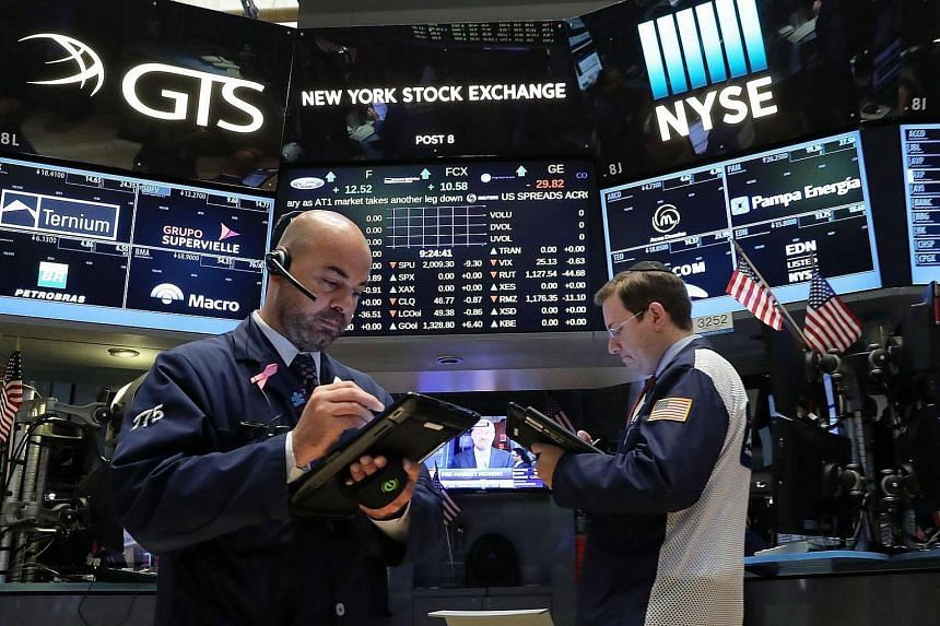 Traders work on the floor of the New York Stock Exchange on June 27.