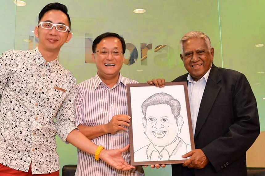 Mr Lawrence Koh (left) presented former president S R Nathan with a caricature in 2015. In attendance is former MP Seng Han Thong (centre).