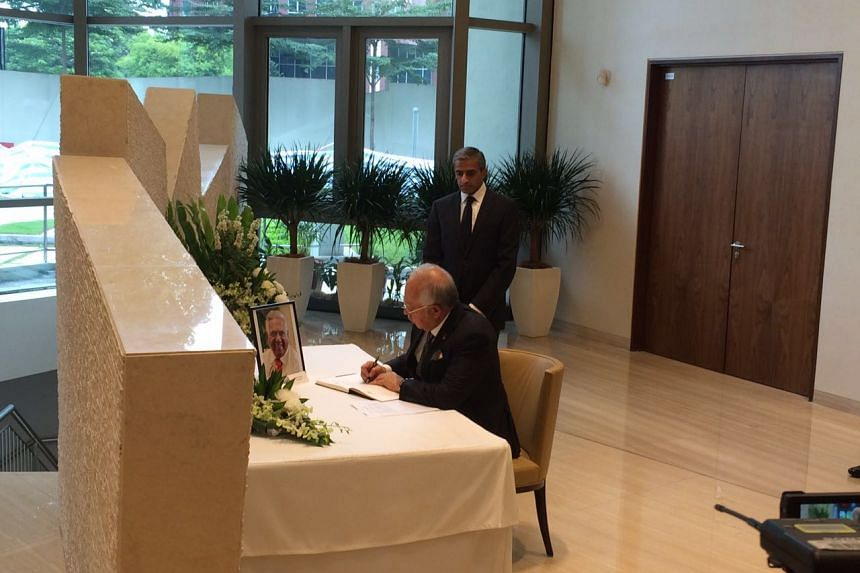 Malaysian Prime Minister Najib Razak signing the condolence book for former Singapore president S R Nathan at the Singapore High Commission in Kuala Lumpur on Aug 26, 2016. Standing behind him is Singapore High Commissioner Vanu Gopala Menon.