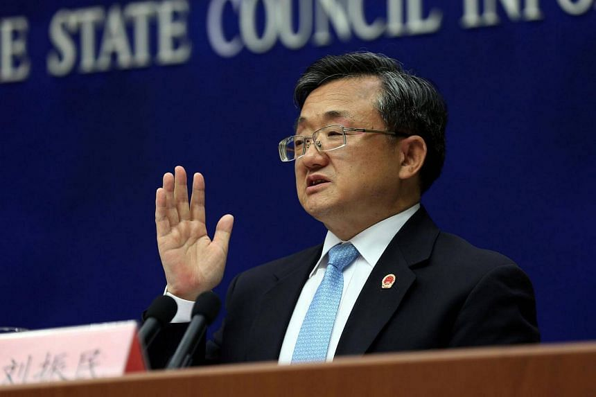 China's Vice Foreign Minister Liu Zhenmin speaks during a news conference in Beijing, July 13.