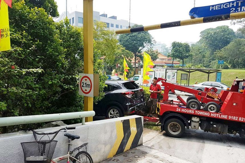 An SUV nearly fell four metres into the basement of a building after it crashed into a railing on Bukit Batok Street 23.