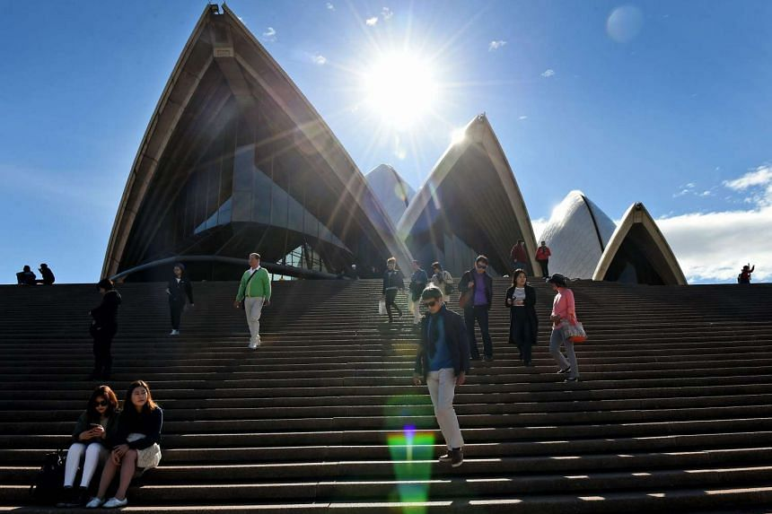 Tourists walking down the front stairs of the Sydney Opera House on June 7, 2016.