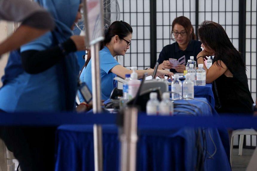 Residents getting tested for tuberculosis at the screening stations at Block 203 Ang Mo Kio Avenue 3.