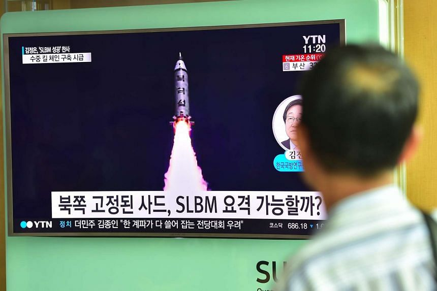A man watching a television screen reporting news of North Korea's latest submarine-launched ballistic missile test at a railway station in Seoul on Aug 25, 2016.