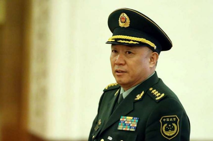 Wang Jianping, then Commander of Chinese People's Armed Police Force, attends a meeting in Beijing, China, March 10, 2014.