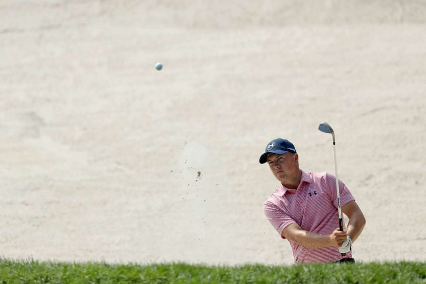 Jordan Spieth plays his second shot on the par 3, 17th hole during the second round.