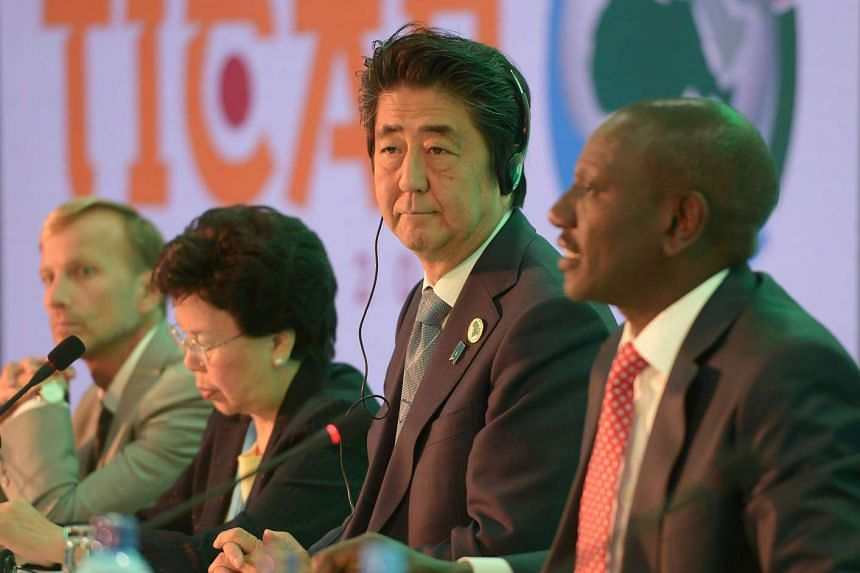 Japanese Prime Minister Shinzo Abe (centre) listening to Kenya's Deputy President William Ruto during a session with Kenya's Ministry of Health and world Bank group at the TICAD conference on Aug 26, 2016, in Nairobi.