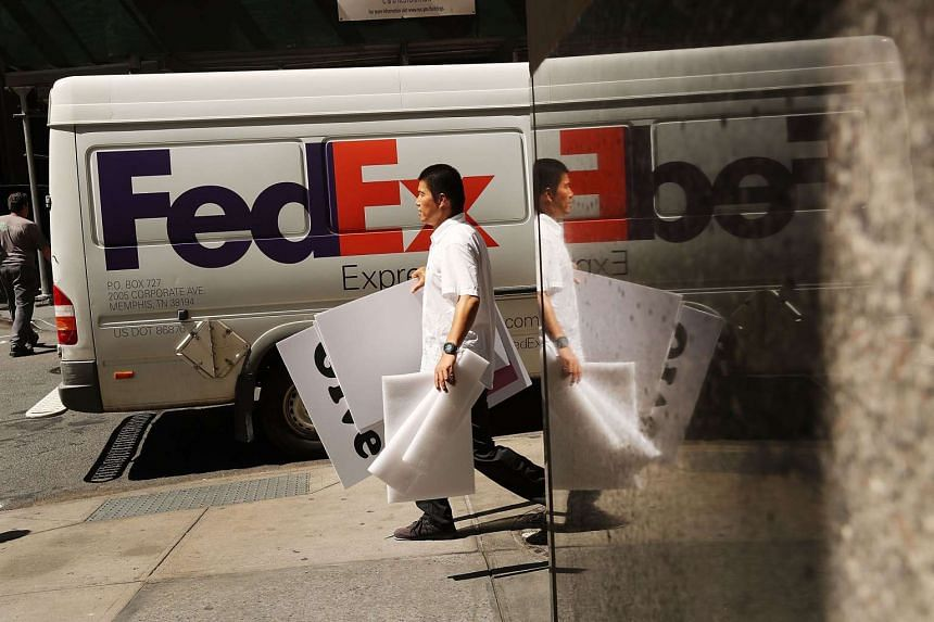 A man walks in front of a FedEx truck near the New York Stock Exchange on Aug 26. Despite the slowing growth rate Fed Chair Janet Yellen voiced optimism about the economy at the central bank's annual Jackson Hole summit.