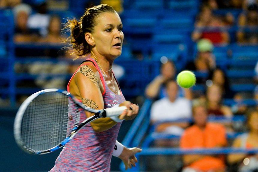Agnieszka Radwanska of Poland returns a shot to Petra Kvitova of the Czech Republic on day 6 of the Connecticut Open at the Connecticut Tennis Center at Yale on Aug 26.