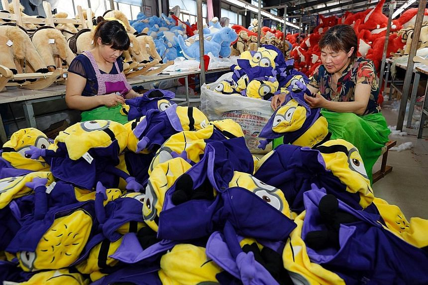 Workers making soft toys at a factory in China's Jiangsu province. As the size of Asean's middle class is expected to more than double by 2025 to include 125 million households, its new consumers will buy not only brands from the West and Japan, but