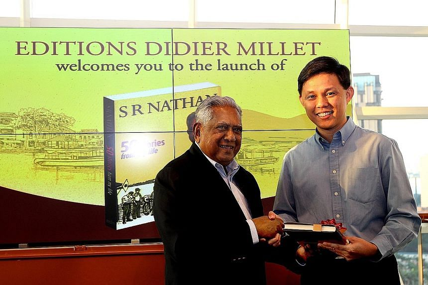Mr Nathan presenting his book, 50 Stories From My Life, to Mr Chan at its launch in 2013. Mr Chan was the guest of honour at the event.