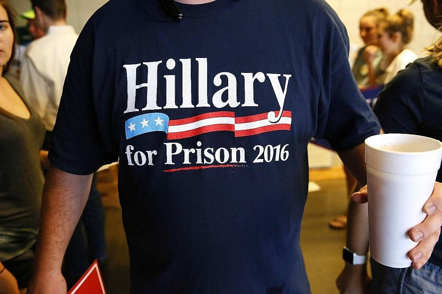 A Trump supporter sporting an anti-Clinton shirt before a rally for the Republican nominee in Jackson, Mississippi, on Wednesday. The two presidential candidates have been accusing each other of racism.