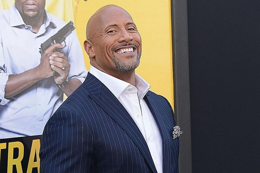 """Dwayne """"The Rock"""" Johnson more than doubled his earnings last year to US$64.5 million (S$87.2 million)."""