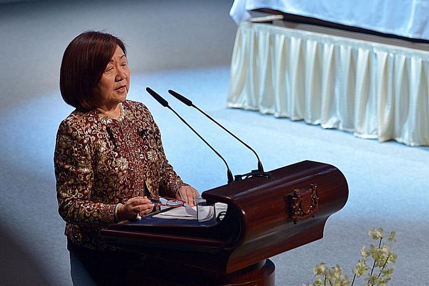 Business leader Jennie Chua tells the crowd at the funeral service that her outfit is made from the sari Mrs Nathan gave her.
