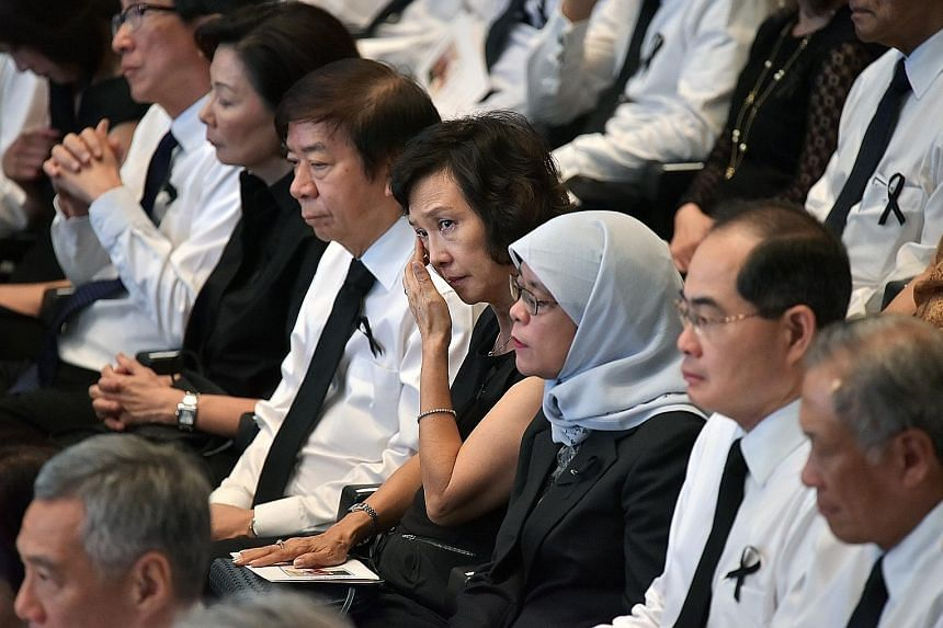 The funeral service booklet, in honour and memory of Mr Nathan's lifetime of achievements and his dedicated service to Singapore. Government leaders and their wives who attended yesterday's funeral service included (above, from left) Mr and Mrs Lim S