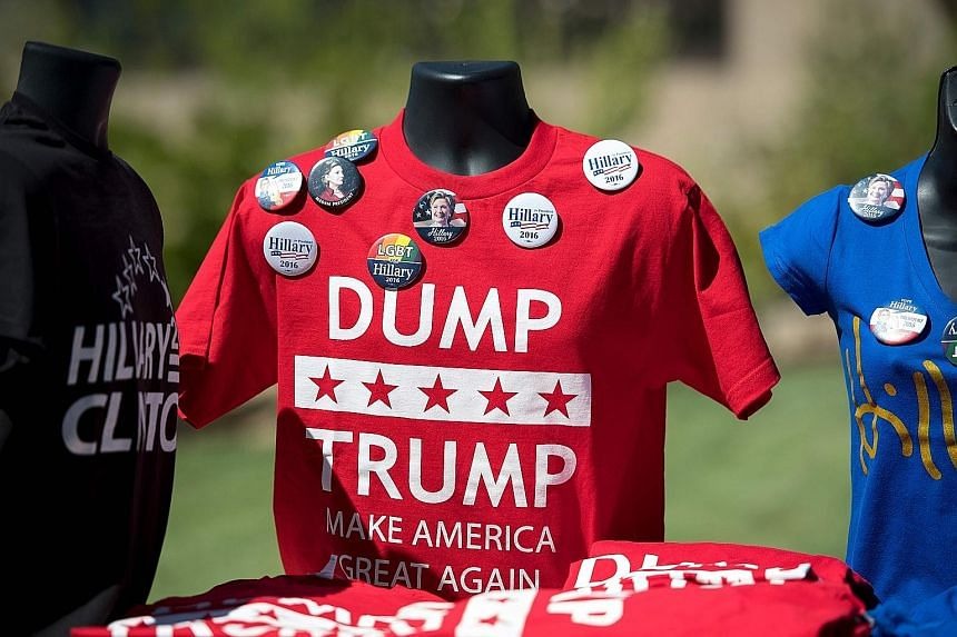 Shirts and pins on sale outside a campaign event where Mrs Clinton was due to speak in Reno, Nevada, on Thursday. Mrs Clinton listed nearly every racially insensitive comment Mr Trump has made.