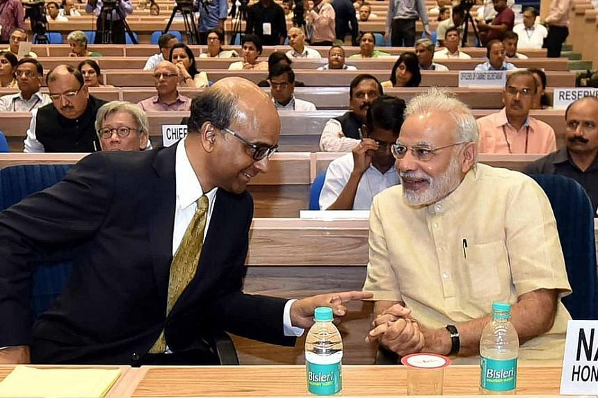 Mr Tharman (left) with Mr Modi in New Delhi yesterday. They discussed various joint initiatives between Singapore and India, including skills development and smart cities.