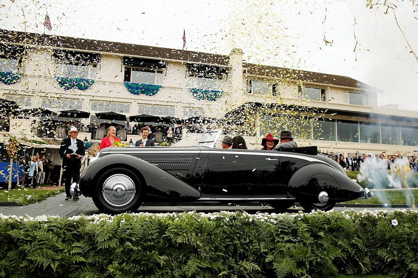 Among the vehicles on display were a 1959 Ferrari SpA 250 GT LWB California Spider (above) and a 1932 Bugatti Type 55 Roadster (left). The 1936 Lancia Astura Pinin Farina Cabriolet had bodywork by Italian design powerhouse Pininfarina and had once b