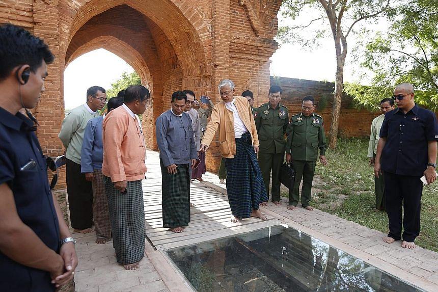 Myanmar President Htin Kyaw (centre) visiting a damaged temple in Bagan on Thursday. The quake destroyed 241 Bagan pagodas.