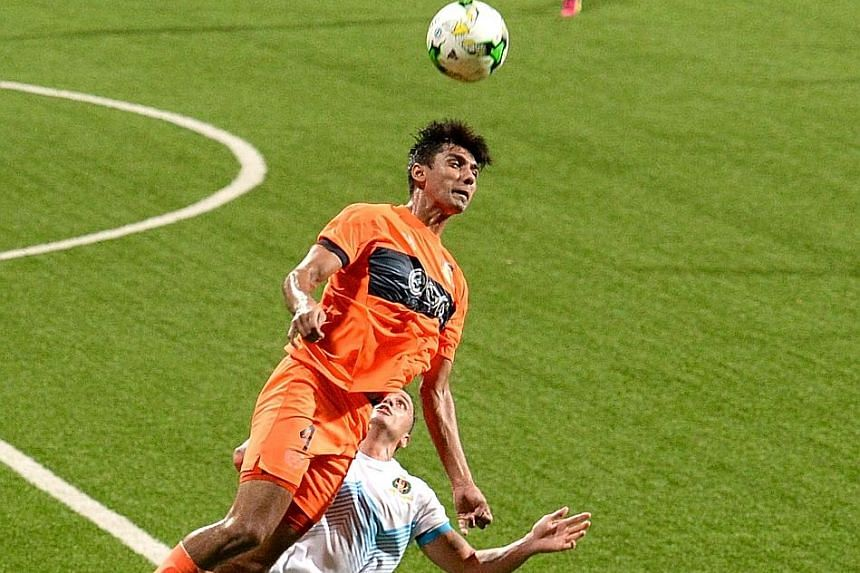 Hougang United's Delwinder Singh rising high to head the ball during his team's 1-2 S-League loss to Brunei DPMM at the Jalan Besar Stadium last night.