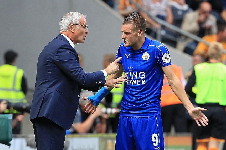 Leicester manager Claudio Ranieri passing instructions to striker Jamie Vardy in their season opener against Hull. Vardy has yet to find the net this season, but Ranieri is confident he can eventually work well with new strike partner Ahmed Musa.