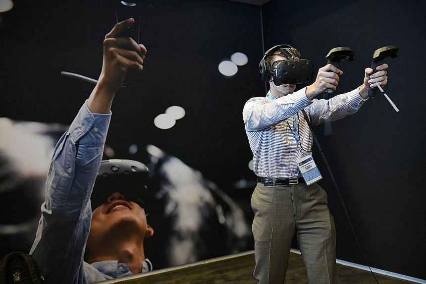 A game player using an Oculus Rift virtual reality headset at the 2016 Intel Developers Forum in San Francisco this month. Today's mix of youthful safety and adult immaturity may be a feature of life in a society increasingly shaped by the Internet's