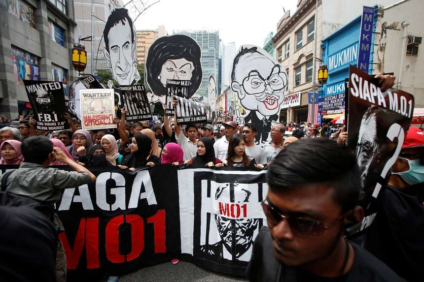 "Student activists shout slogans as they prepare to march towards Dataran Merdeka, or Independence Square, to call for the arrest of ""Malaysian Official 1"" in Kuala Lumpur on Aug 27, 2016."