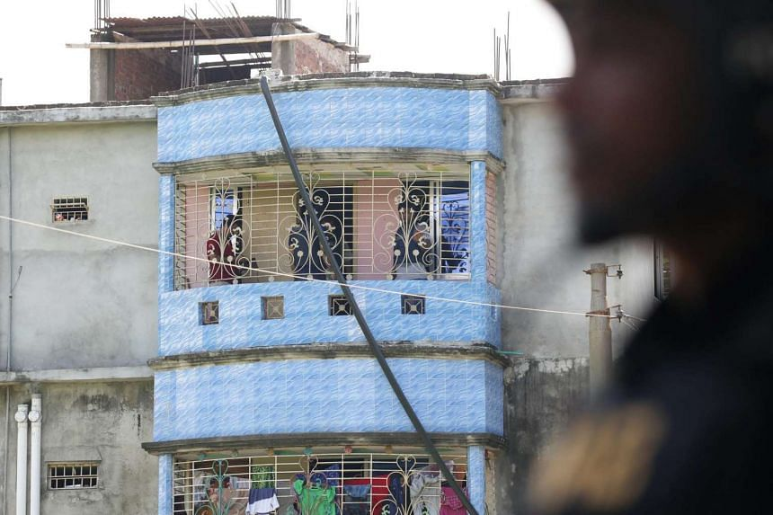 Bangladeshi police inspect a two-story house after a raid in Narayanganj on the outskirts of Dhaka, Aug 27, 2016.