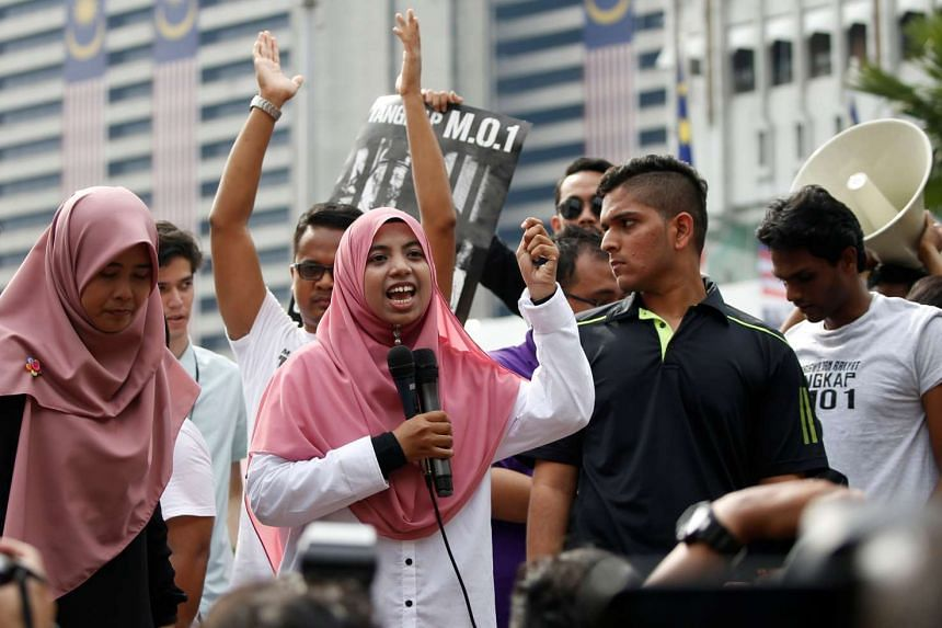 "Organizer of student activists Anis Syafiqah Md Yusof speaks to participants near Dataran Merdeka or Independence Square, to call for the arrest of ""Malaysian Official 1"" in Kuala Lumpur on Aug 27, 2016."