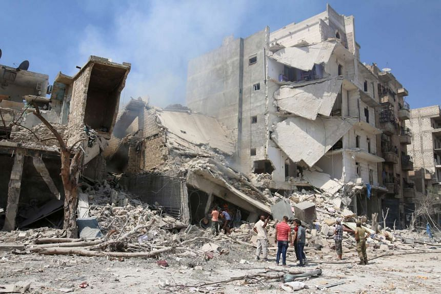 Men inspect a damaged site after double airstrikes on the rebel held Bab al-Nairab neighborhood of Aleppo, Syria, Aug 27, 2016.