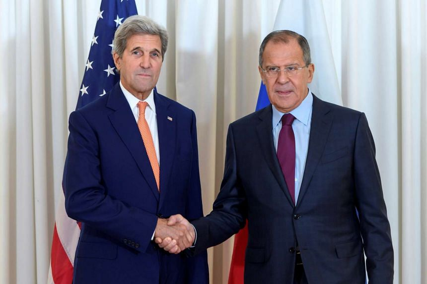 US Secretary of State John Kerry (left) and Russian Foreign Minister Sergei Lavrov shake hands during the bilateral meeting on Syria