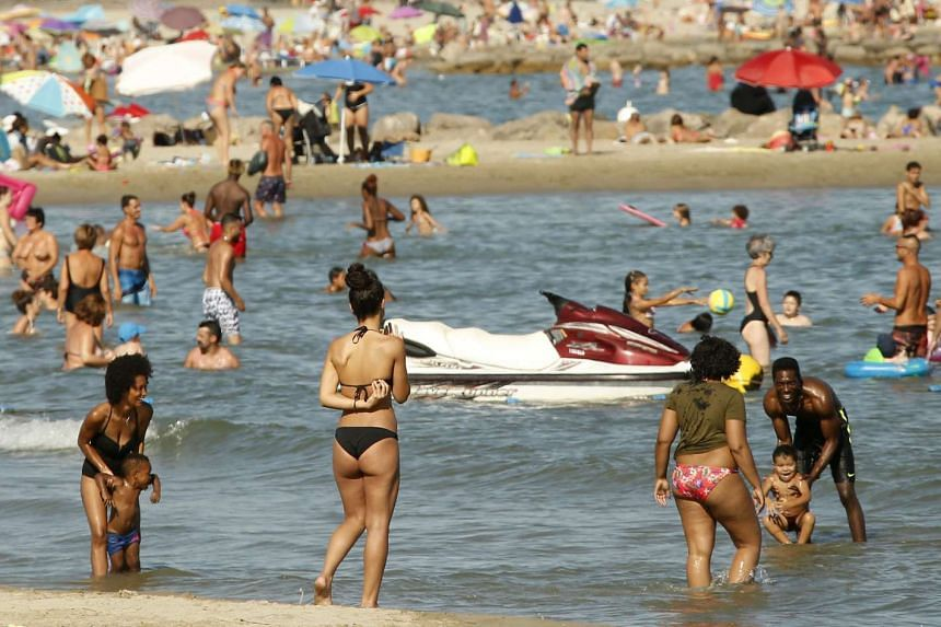 People enjoy the beach of Palavas les flots, in southern France, Aug 26, 2016.