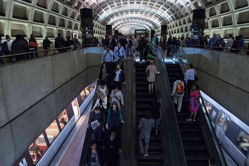 Commuters at the L'Enfant Plaza Metro station in Washington, DC. An improved labour market in the US in recent months is adding weight to the argument that it is time for the country's central bank to raise interest rates.