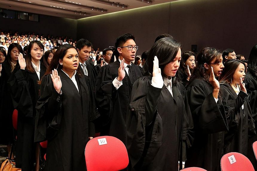 The new batch of freshly-minted lawyers taking their oath yesterday. Over three sessions at the Supreme Court auditorium, a total of 509 lawyers were called to the Bar.