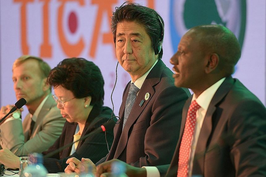 Mr Abe listens to Kenyan Deputy President William Ruto (right) during a session of the Tokyo International Conference on African Development, in Nairobi. While at the conference, being held in Africa for the first time, the Japanese Prime Minister pl