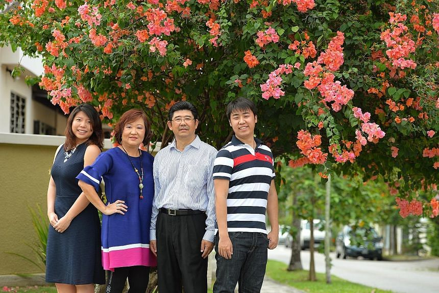 Ms Susan Tong (second from left) and her husband David Koh (third from left), a 57-year-old retiree, outside their corner terrace house in Yio Chu Kang, with the second of their three sons, Lionel (extreme right), 28, a strategy analyst, and his wife