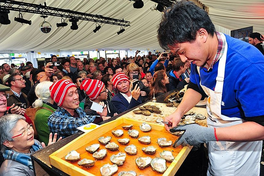 The oyster- shucking championship (above) is one of the highlights at Ireland's Galway International Oyster & Seafood Festival.