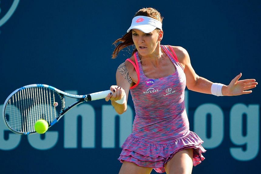 Agnieszka Radwanska returning a shot to Elina Svitolina at the Connecticut Open in New Haven, Connecticut, on Aug 27, 2016.