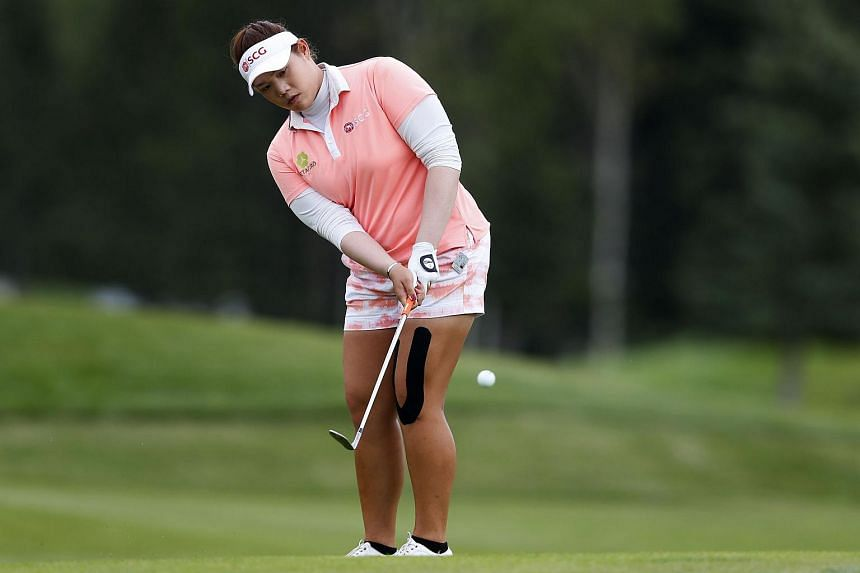 Ariya Jutanugarn chipping onto the 18th green at the Canadian Pacific Women's Open at Priddis Greens Golf and Country Club in Calgary, Canada, on Aug 27, 2016.