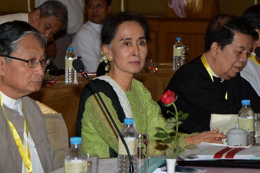 Aung San Suu Kyi (centre), flanked by government peace negotiators Kyaw Tint Swe (left) and Tin Myo Win, in Naypyidaw in preparation for the ethnic peace conference on May 27.