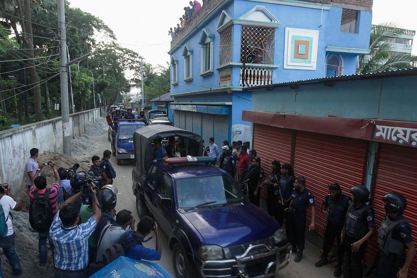 Bangladesh policemen escort the bodies of suspected militants following an operation to storm a militant hideout in Narayanganj on Aug 27, 2016.