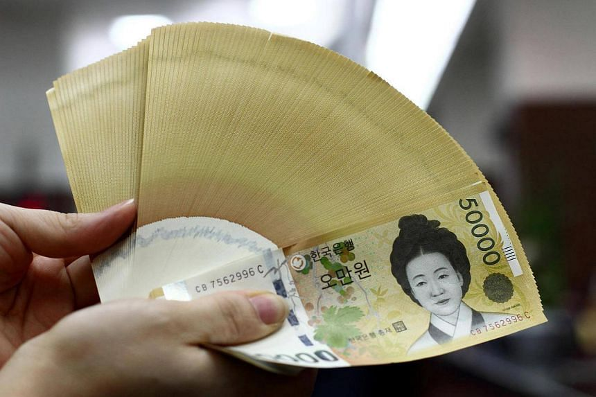 South Korean won banknotes are arranged for a photograph on July 17, 2012.