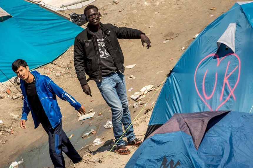 Refugees at the migrant and refugee camp in Calais, France, on June 24, 2016.