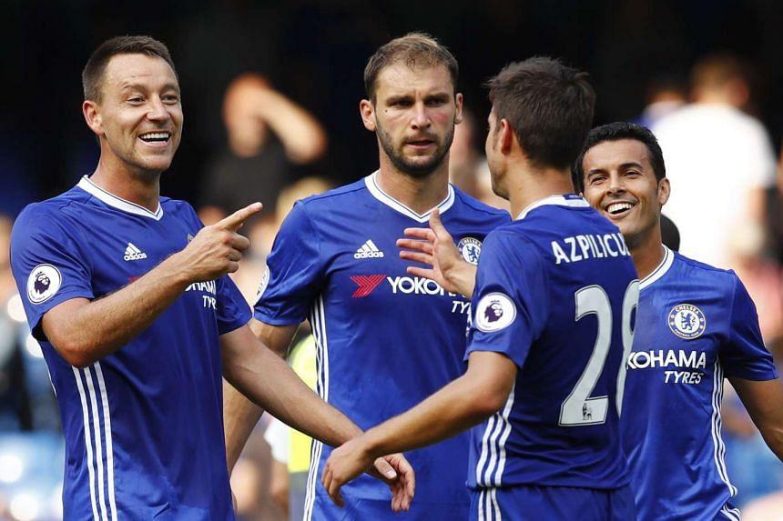 (From left) Chelsea's John Terry, Branislav Ivanovic, Cesar Azpilicueta and Pedro celebrate at full time.